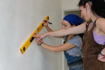Two young female decorators