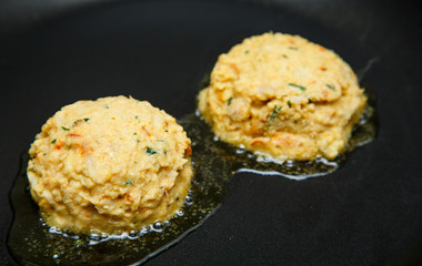 Raw Crab Cakes Placed in Hot Oil