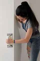 Young woman finishing off a wall