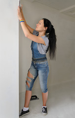 Shapely young woman redecorating her apartment