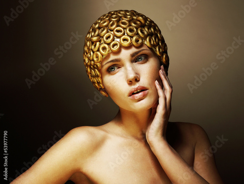 Creativity. Surreal Stylized Woman with Golden Headwear. Helmet
