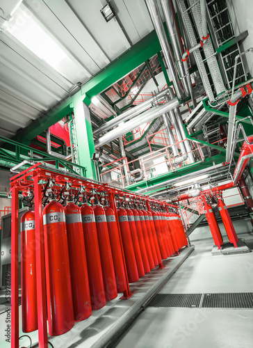 Large CO2 fire extinguishers in industrial interior