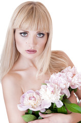 Blonde woman with flowers over white background.