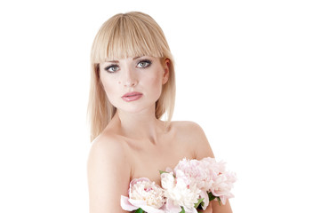 Sensual portrait of a blond woman with flowers on a white.