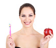 Smiling woman with apple and toothbrush isolated on white