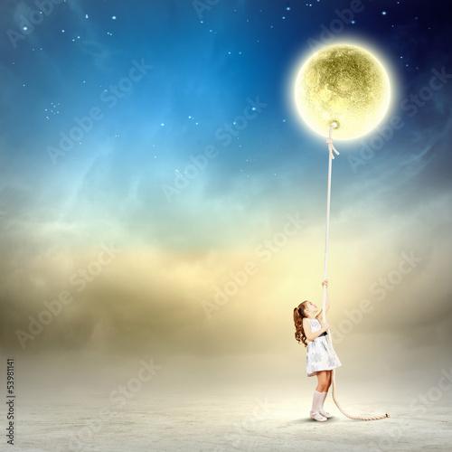 Fototapeta Little girl pulling moon
