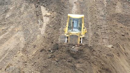 Yellow Bulldozer Raking Clay