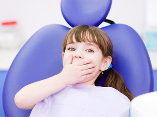 frightened girl at dentist's office