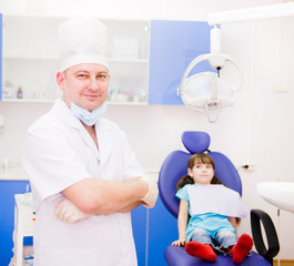 portrait dentist with patient in the background