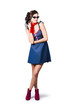 Pin up styling fashion girl in retro denim dress