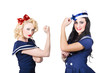 Pin-up sailor girls showing physical strength