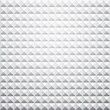 Grey textured pyramid background.