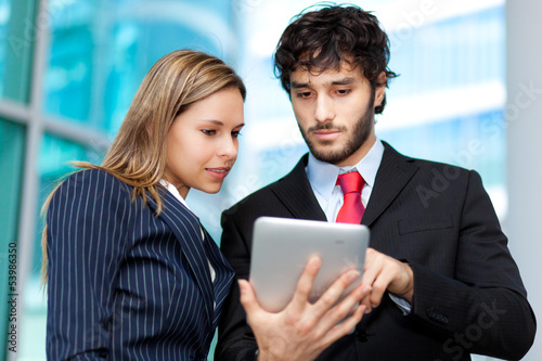 Two young businesspeople at work