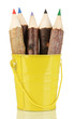 Colorful wooden pencils in yellow pail isolated on white