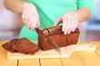 Woman slicing black bread