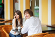 man and woman dating at cafe