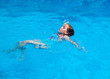 Child swimming backstroke
