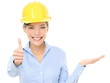 Engineer woman showing thumbs up and product