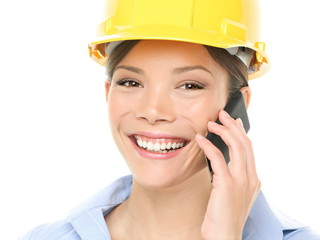 Engineer - Woman with Hardhat on Mobile Phone