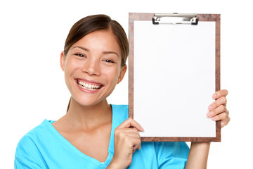 Happy Female Doctor Holding Blank Paper On Clipboard