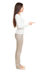 Young Woman Pointing At Copyspace