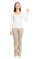 Young Woman Pointing Up At Copyspace
