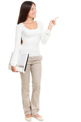 Woman Holding Laptop While Pointing At Copyspace