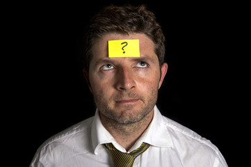 man with yellow postit note on his forehead
