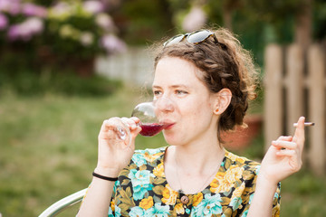 Beautiful young woman drinking sangria