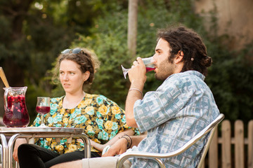 Couple of friends drinking sangria outdoors