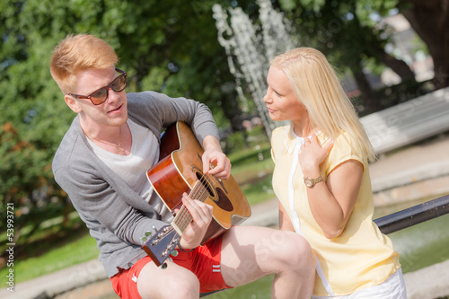 Young Couple with Guitar at Park