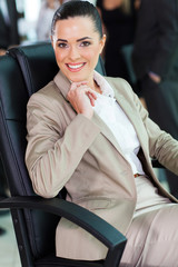 cute businesswoman sitting in office