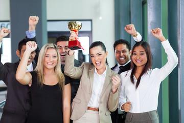 cheerful business team winning an award