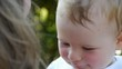 HD1080p25 Face of young baby happy in a mother´s hands