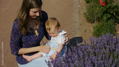 HD1080p25 Young blond baby (10 months old) exploring Lavender fl