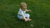 HD1080p25 Cute little baby playing with pacifier in the park