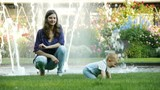 HD1080p25 Young mother playing with baby in the garden