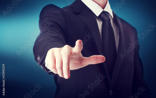Business man with pointing to or touching a touch screen