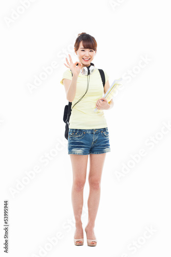 Young happy Asian student show OK sign