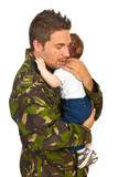 Military dad hugging his newborn baby