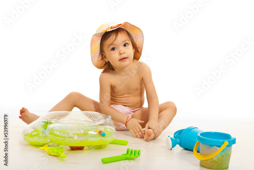 Beauty toddler playing with beach toys