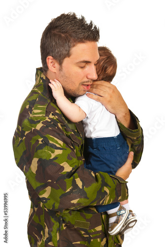 Military dad hugging his newborn baby