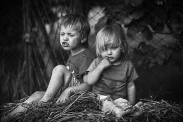 boy and girl in the hay, black and white