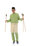 Malay male celebrating hari raya with oil lamp and isolated whit