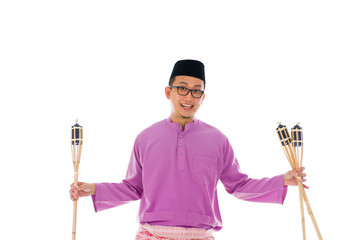 Malay man celebrating hari raya the month after ramadan