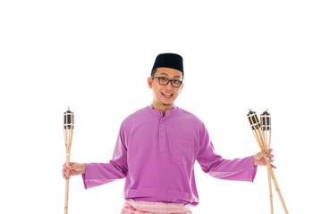 Malay man celebrating hari raya the month after ramadan