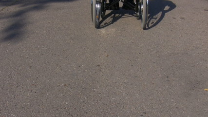 Man in a wheelchair moves away from camera
