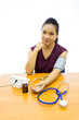 woman happy with her self blood pressure test