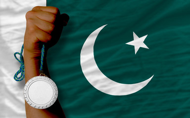 Silver medal for sport and  national flag of pakistan