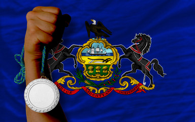 Silver medal for sport and  flag of american state of pennsylvan